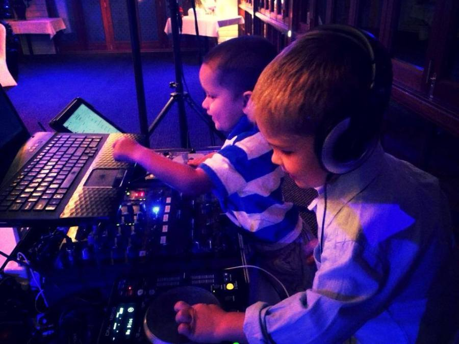 Kids playing with DJ Equipment